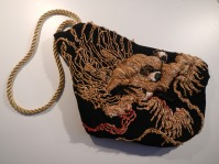 From an antique 1920s Chinese nightgown, embroidered with dragons and clouds, but now reduced to fragments, is born this black silk clutch, padded and lined in black silk. pochette dragone realizzata da un frammento di antica vestaglia cinese di fine '800